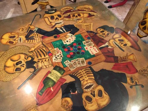 This table (and matching chairs) are a riff on the velvet painting of dogs playing poker.